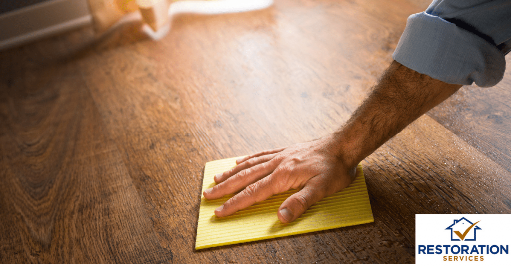 hardwood floor water damage repair warping services